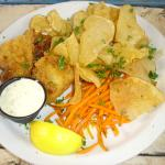 The 2-piece Bell's Battered Fish and Chips, with cooked shoestring carrots, tartar sauce and lem
