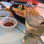 Chips and salsas with a mojito