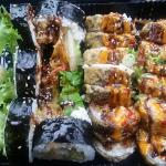 Dragon roll and shrimp tempura. Ooohhh yes! Best sushi!! Get choo some. 😜