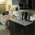 Kitchenette w/ Kuerig coffee maker, frig, sink, cupboards, and micro