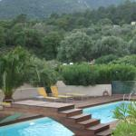 Pool surrounded by maquis and mountains