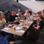 Our motorcycle group enjoying a meal and drink together