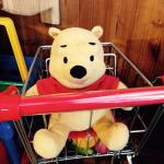Delightful shopping options. A cute Winnie the Pooh in a mini grocery cart in the window!