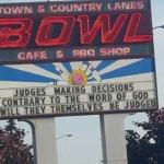 """Bigoted sign, and no apology, just a """"Love the sinner, hate the sin"""" backtrack."""