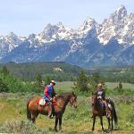 Riding with the Grand Tetons in the background