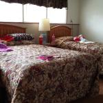Bedroom with a queen and twin bed.  Both rooms have full bathrooms.