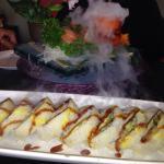 Salmon sashimi, salmon and avocado roll and jumbo dynamite roll