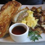 "The ""62"" - Brioche French toast, potatoes, eggs, chic sausage"