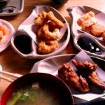 an assortment of tempura, chicken wings, miso soup