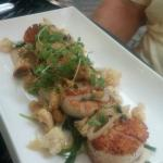 Sautéed Diver Scallops with roasted cauliflower, golden raisins, shallots, capers, and melted le