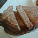 French Toast, Eggs, and Ham in photo 1.  A massive cinnamon roll in photo 2. Cinnamon Bread Toas