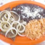 Awith refried beans and ricerrachera