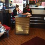 Waitress on there phone while we wait for a table with plenty empty smh