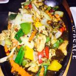 16 candles (wok fried chicken and vegetables in black pepper on a hot plate) AED 45