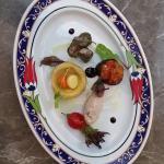 Turkish Mezze Platter ; vegetables in olive oil,hummus, grape leaves with rice,mini imam bayildi
