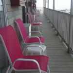 upstairs balcony loung chairs outside each room
