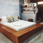 Queen sized mahogany platform bed with 4 hidden drawers and built-in end tables and benches.