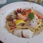 Tomatoes, capers, garlic and basil, salmon, mahi, prawns, halibut and clams with fettuccine