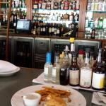 Half eaten lunch and spirits shelf
