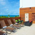 Soak in the Florida sun on our Rooftop Sundeck