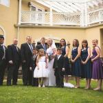 The bridal party in front of Stone Manor