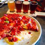 Delicious pizza a me beer sampler. Outstanding food, great service. Very family friendly.