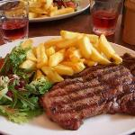 A beautiful steak dinner with salad and chips.. N.Z or Aussie steak, can't recall sorry.