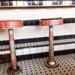 Art deco style original tiles and counter stools