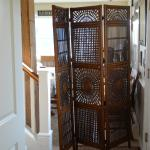 Creepy room divider in front hall the owners startle you from