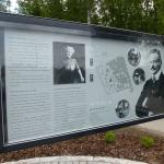 An interpretation board by the entrance to Ainola