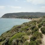 Katelios. Left to right - the harbour, tavernas & the beach