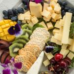 Cheese, crackers and fruit trays for celebrations.