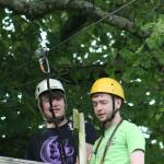 Shaun Downey explaining to Josh how use the zip line