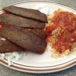 Overcooked gyro and rice with tomato paste on it