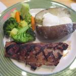 7 ounce Sirloin Steak, Baked Potato with mixed fresh Vegetables
