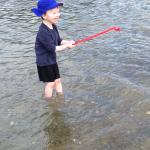 Happiness is a little red rake and lots of water at Windward Cottages!