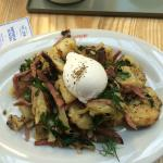 Pulled Corned beef, potato, herb hash with a poached egg