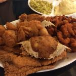 Food photos are seafood combo plate for two and Salmon pattie with crab cake.