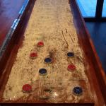 Shuffleboard, greatest bar game in the history of bar games