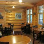 Dining area has windows with a view of Poplar Lake