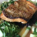Golden South Pacific Tile fish. In a orange miso broth. Chopped baby Bok Choy, and black forbidd