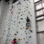 The wife conquering one of the 8 auto Belay walls, on her first time climbing.