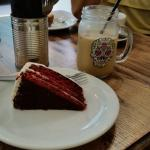 Ice cold latte and red velvet cake