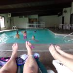 Relaxing by the pool while kids swim.