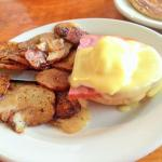 Over cooked Eggs Benedict half order with inconsistently cooked potatoes