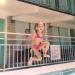 Kids having fun in the kiddie pool, Emma jumping in Big Pool n lounging in the bedroom at Motel