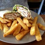 Chicken caesar wrap with salad and awesome chips