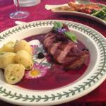 Pan-fried breast of duck with a port and berry sauce