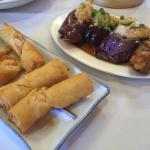 Shrimp spring rolls and eggplant with shrimp.