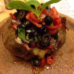 Potato with onion, tomatoes, olives and basil